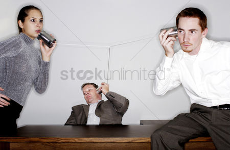 Guys : Businessman eavesdropping on a tin can phone conversation