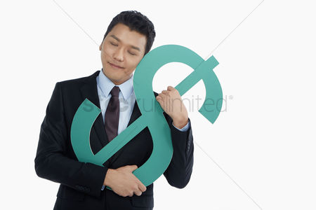 Business suit : Businessman embracing a dollar sign