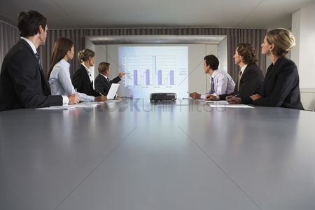 Business suit : Businessman giving presentation in conference room