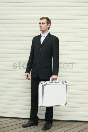 Cardboard cutout : Businessman holding briefcase