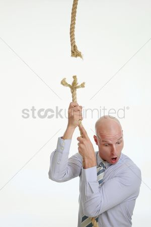 Bald : Businessman holding on to a frayed rope