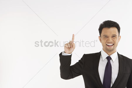 Masculinity : Businessman holding up index finger