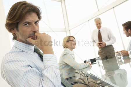 Contemplation : Businessman in conference meeting  portrait