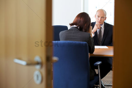 Bald : Businessman in discussion with businesswoman
