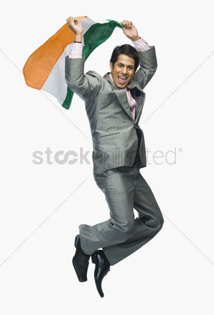 Respect : Businessman jumping with holding indian flag