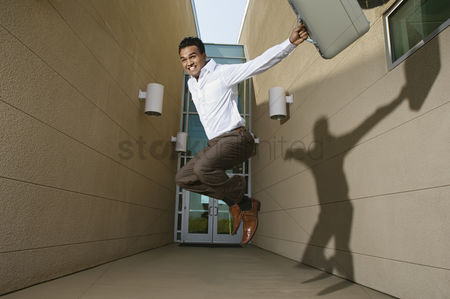 Gladness : Businessman jumping