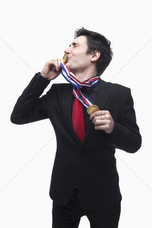 Kissing : Businessman kissing gold medal