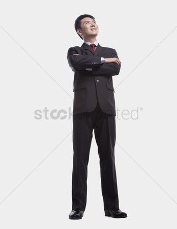 Proud : Businessman looking up  full length