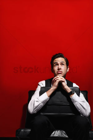 Frowning : Businessman looking worried