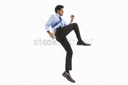 Fight : Businessman posing on the floor  showing fighting gestures