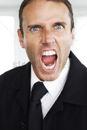 Rage : Businessman screaming at the camera
