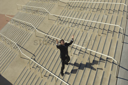 Stairs : Businessman shouting on stairs elevated view