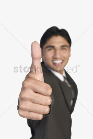 Corporation : Businessman showing thumbs-up sign