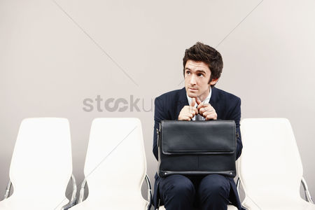 Three quarter length : Businessman sitting on chair  waiting