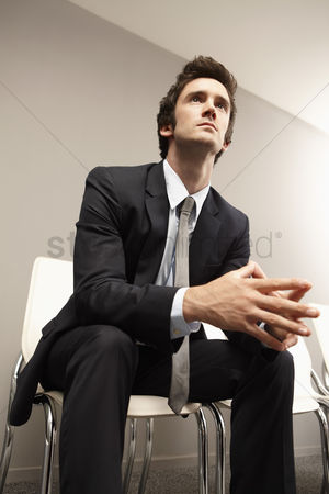 Contemplation : Businessman sitting on chair  waiting