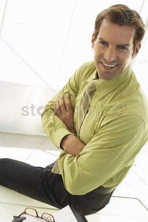 Gaze : Businessman sitting on desk