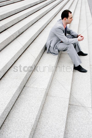 Staircase : Businessman sitting on the staircase