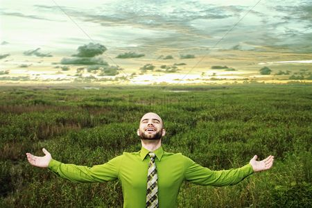 Grass : Businessman standing with his arms outstretched