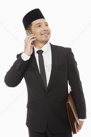 Portability : Businessman talking on his mobile phone