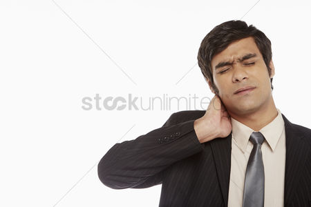 Frowning : Businessman touching his neck