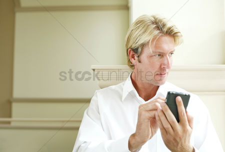 Pocket : Businessman using a handheld device