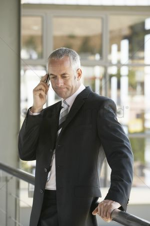 Frowning : Businessman using cell phone