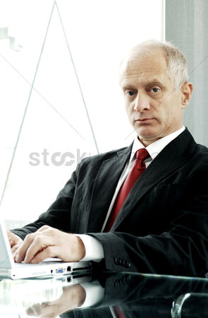 Determined : Businessman using laptop in his room