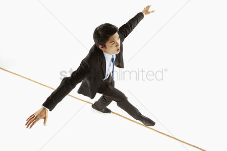 Rope : Businessman walking on a rope