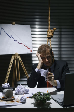 Loss : Businessman with a noose around his neck holding crumpled paper