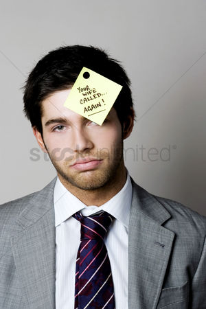 Supervisor : Businessman with a phone message sticking on his forehead