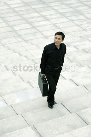 Staircase : Businessman with briefcase standing at the staircase
