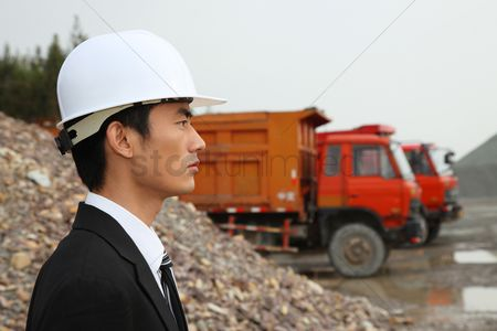 Truck : Businessman with hardhat on construction site