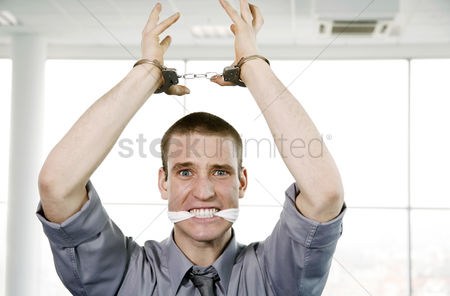 Sales person : Businessman with his hands being cuffed and his mouth being stuffed with cloth