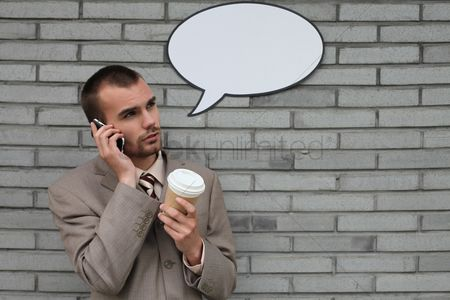 Cardboard cutout : Businessman with speech bubble talking on the phone and holding a cup of coffee