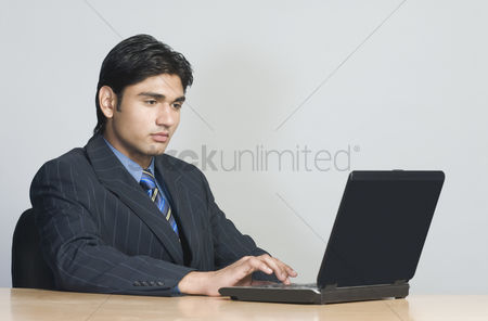 Corporation : Businessman working on a laptop