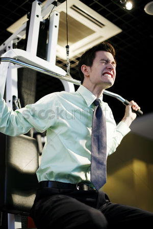 Lively : Businessman working out in the gym