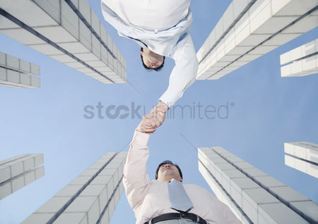 Sales person : Businessmen greeting each other
