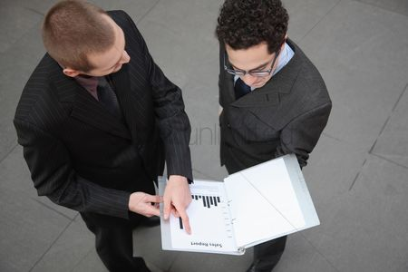 Eastern european ethnicity : Businessmen looking at sales report