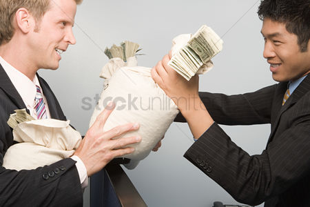 Interior : Businessmen passing money