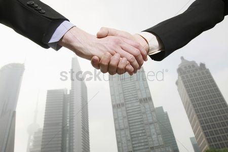 Appearance : Businessmen shaking hands
