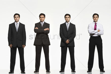 Mid adult man : Businessmen standing side by side arms crossed by side clasped digitally enhanced