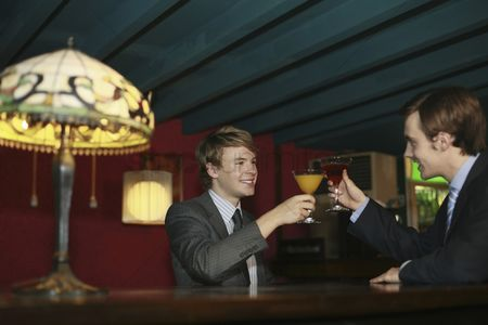 Toasting : Businessmen toasting cocktails