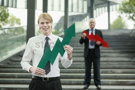 Stairs : Businessmen with arrow signs