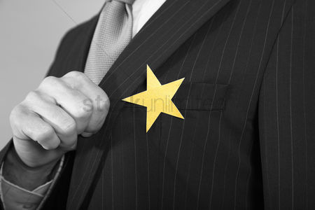 Proud : Businessmen with golden star on suit