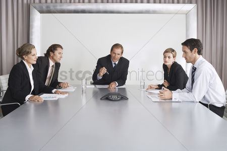 Gesturing : Businesspeople listening during teleconference