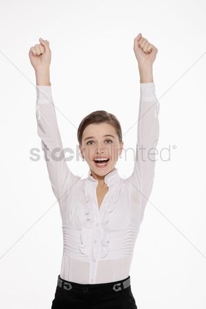 Celebrating : Businesswoman celebrating her success with arms raised