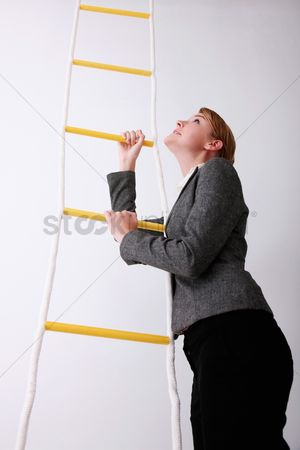Rope : Businesswoman climbing rope ladder