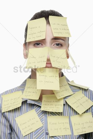 Frowning : Businesswoman covered with adhesive notes