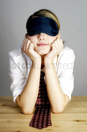 Satisfying : Businesswoman covering her eyes with an eye mask