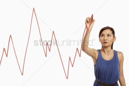 Three quarter length : Businesswoman drawing graph chart on a glass
